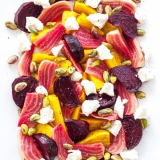 Roasted Balsamic Beet, Goat Cheese and Pistachio Salad | Roasted beets tossed in a white balsamic vinaigrette and plated with crumbles of goat cheese and pistachios. An easy and impressive side dish!