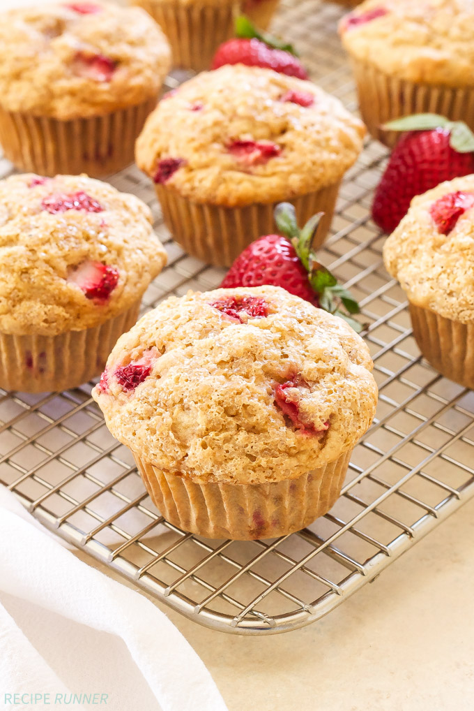 Whole Wheat Strawberry Cheesecake Muffins | 100% whole wheat, loaded with strawberries and stuffed with a dollop of creamy cheesecake filling! Perfect for a spring brunch!