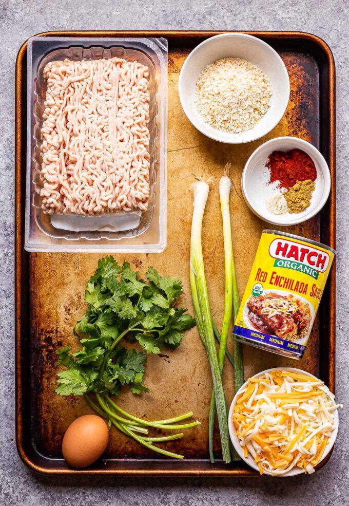 ingredients used to make skillet enchilada meatballs on a sheet pan.