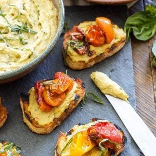 Basil Pesto Hummus and Roasted Tomato Crostini