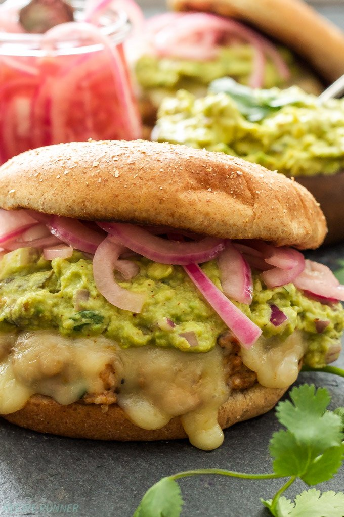 Green Chile Turkey Burgers with Guacamole and Pickled Red Onions |These juicy turkey burgers are packed with Southwest flavor and perfect for grilling this spring or summer!