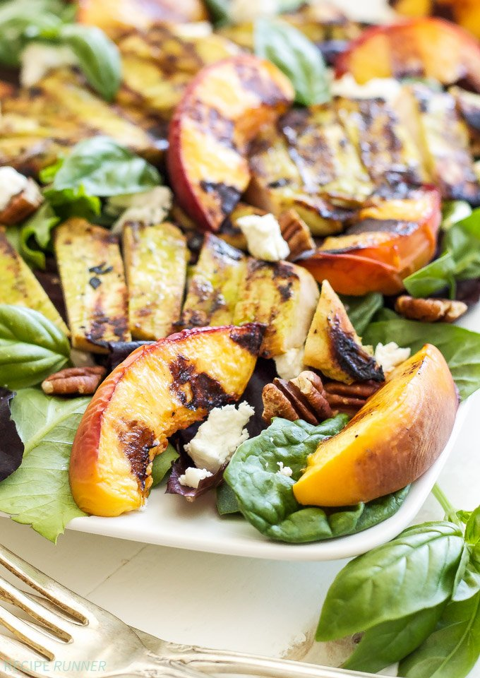 Grilled Chicken, Peach, Pecan, and Goat Cheese Salad with Basil Vinaigrette   Basil Vinaigrette doubles as a marinade for the grilled chicken in the super flavorful summer salad!