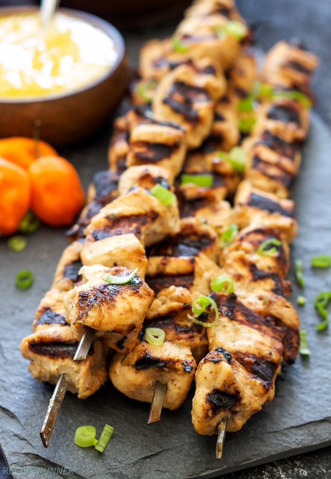 Jerk Chicken Skewers with Mango Habanero Sauce | Full of Caribbean flavor and just the right amount of heat and sweet. Serve with black beans and brown rice for a healthy and filling dinner!