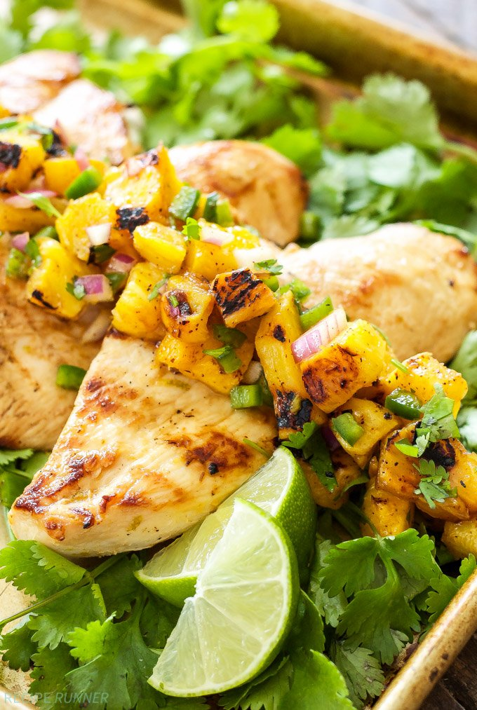 Tequila Lime Chicken with Grilled Pineapple Mango Salsa | Grilled chicken full of citrus flavor and one of the most flavorful salsas you've ever had are perfect for an easy weeknight dinner!
