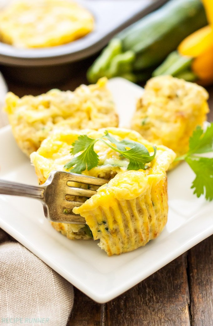 Cheesy Zucchini Quinoa Egg Muffins | Full of protein and carbs, these healthy, freezer friendly, Cheesy Zucchini Quinoa Egg Muffins are the perfect way to start the day!