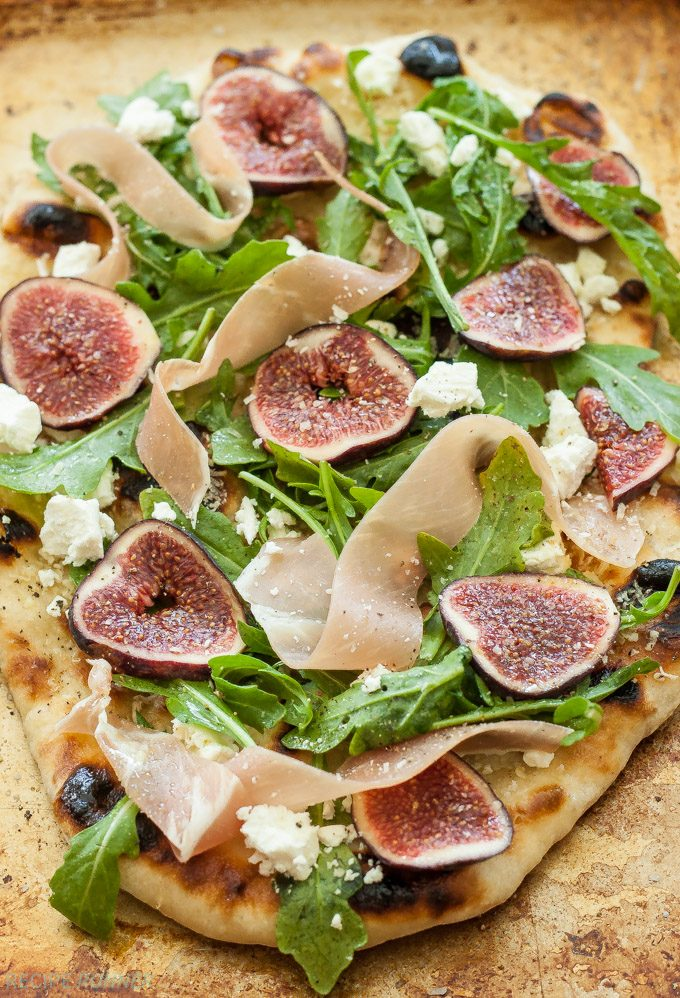 Fig, Prosciutto and Goat Cheese Grilled Pizza on a baking sheet