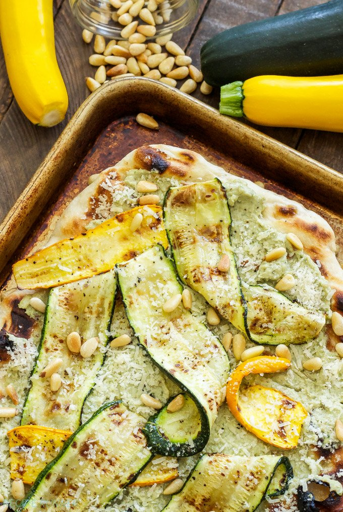 Grilled Zucchini, Ricotta and Pine Nut Pizza | An easy to make grilled pizza topped with zucchini ribbons, ricotta and pine nuts. Perfect for dinner or an appetizer!