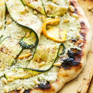 Grilled Zucchini, Ricotta and Pine Nut Pizza on rimmed baking sheet