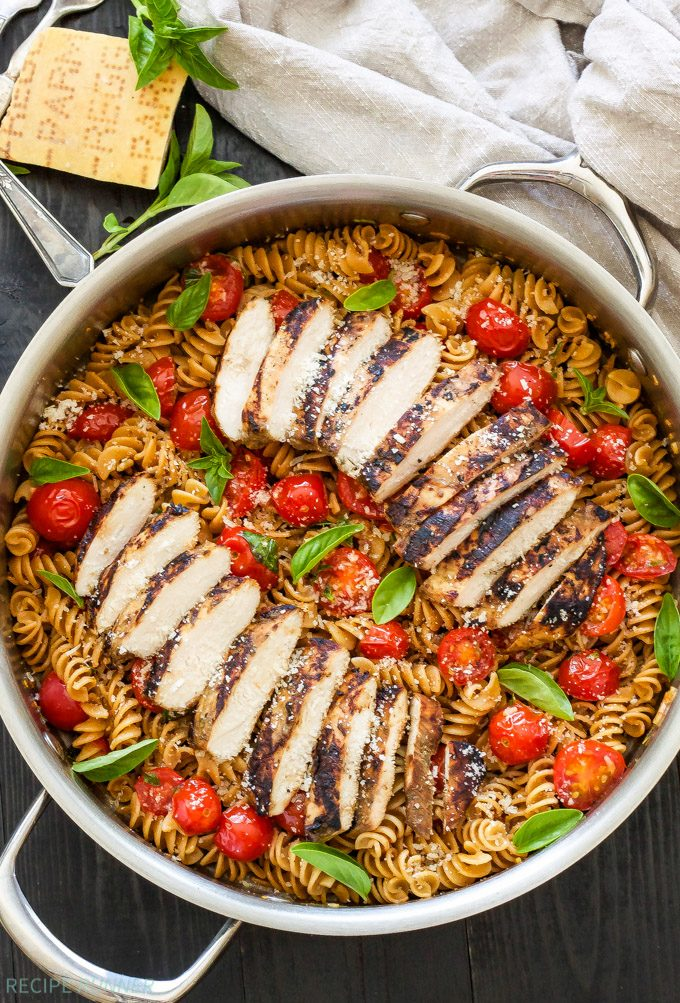 Tomato Basil Pasta with Balsamic Grilled Chicken on top in a silver skillet