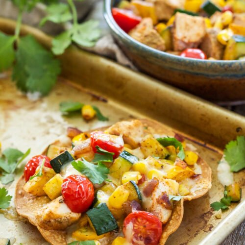 Grilled Chicken and Vegetable Tostadas | Tostadas loaded with grilled chicken, quick sautéed vegetables and pepper Jack cheese. An easy dinner everyone will love!