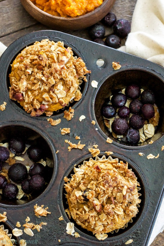 Pumpkin Blueberry Muffins with Oat Streusel | Whole wheat, full of pumpkin, warm spices and a generous amount of sweet blueberries. A perfect breakfast to wake up to on a fall morning!