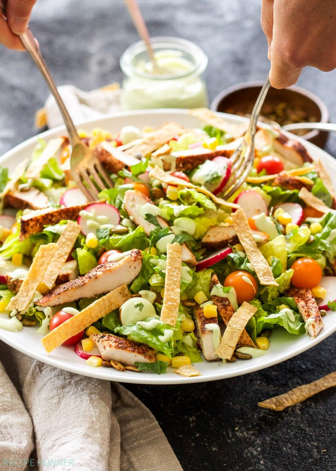 Southwest Chicken Salad with Avocado Lime Dressing | Salad as a main dish? You bet! This Southwest Chicken Salad is loaded with hearty toppings and won't leave you hungry!