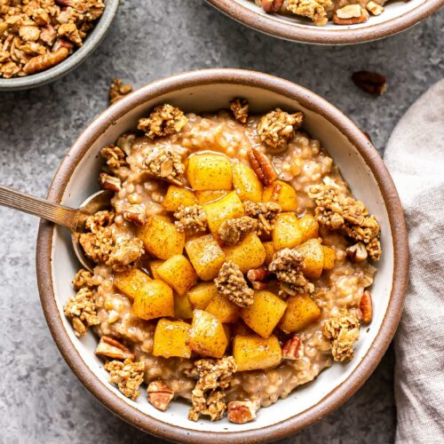 two white bowls with Apple Crisp Steel-Cut Oatmeal ini them.