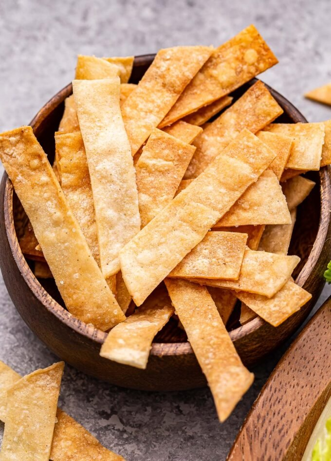 a bowl of baked tortilla strips.
