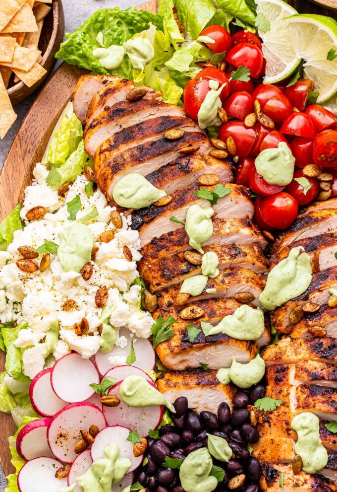 sliced grilled chicken, queso fresco, radishes, black beans, tomatoes all drizzled with Avocado Lime Dressing.