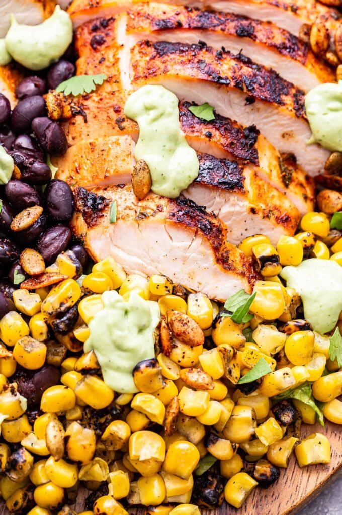 Fire roasted corn and sliced grilled chicken drizzled with avocado lime dressing.