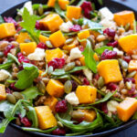 This Butternut Squash Farro Salad with Arugula and Cranberries is loaded with fall flavors! Healthy, whole grain and vegan optional, it's the perfect side dish to add to your Thanksgiving table!