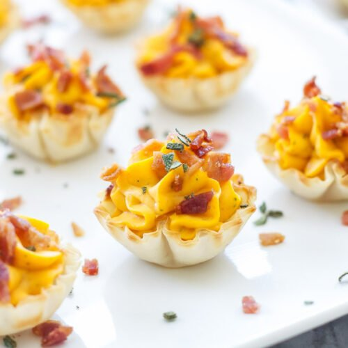 Mini Bacon Butternut Squash Cups | Creamy butternut squash and sage filling piped into mini phyllo shells and topped with salty bacon. The perfect fall appetizer!