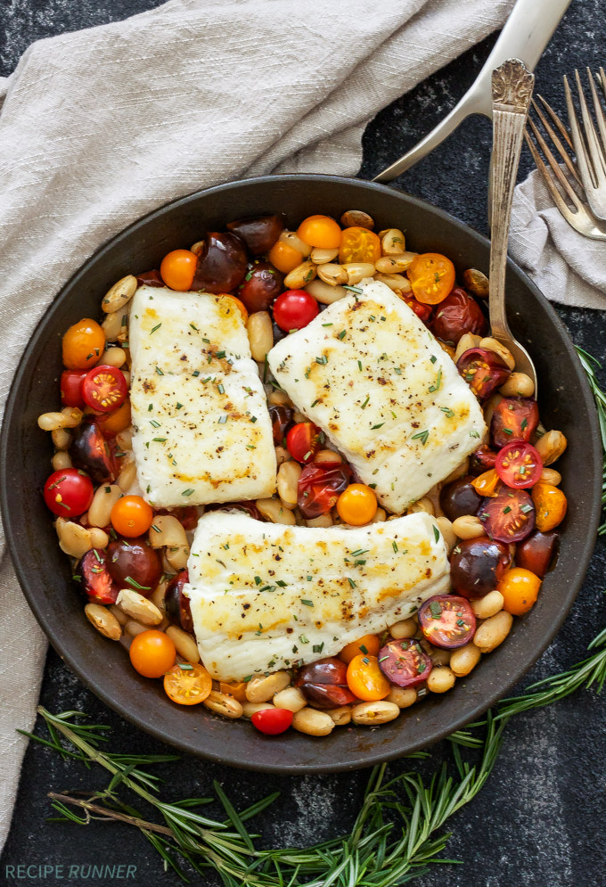 Pan Seared Halibut with Rosemary Tomatoes and White Beans | Flakey halibut paired with the sweet cherry tomatoes, fresh rosemary and creamy white beans is an easy, healthy and delicious dinner!