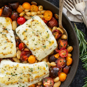 Pan Seared Halibut with Rosemary Tomatoes and White Beans   Flakey halibut paired with the sweet cherry tomatoes, fresh rosemary and creamy white beans is an easy, healthy and delicious dinner!