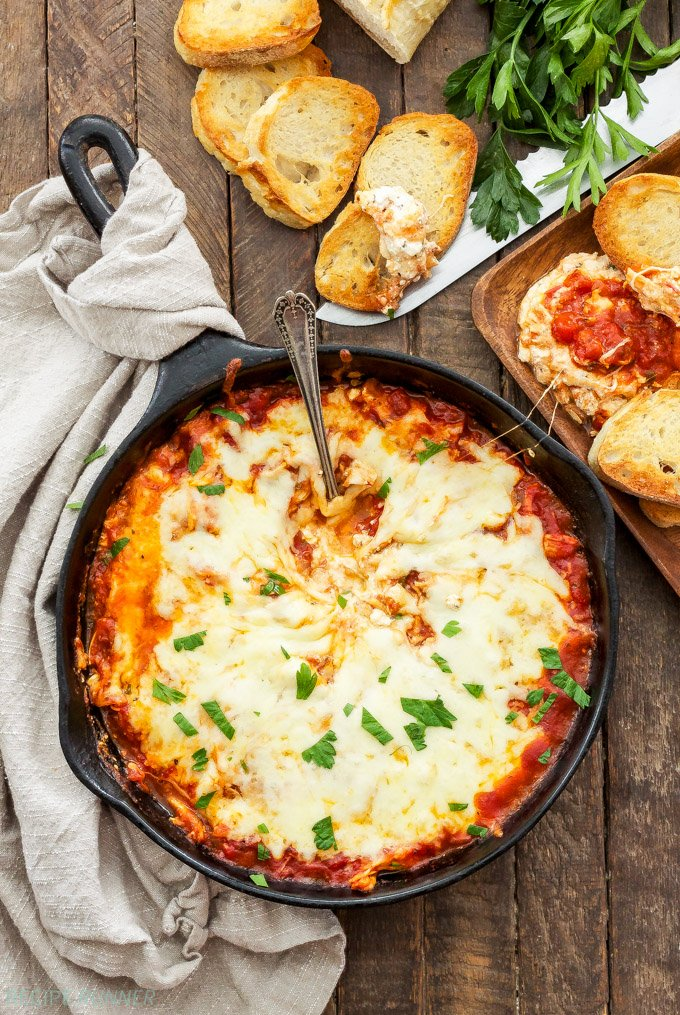 Skillet Chicken Parmesan Dip | Easy to make and full of that chicken parmesan flavor, this dip won't last long at a party!