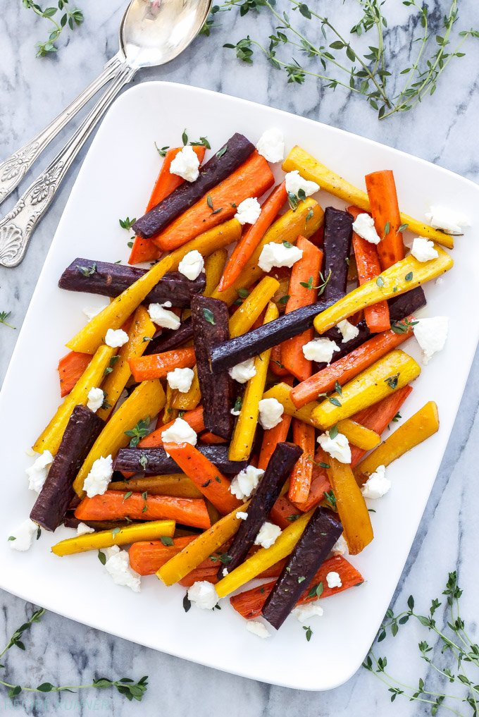 Honey Roasted Carrots with Goat Cheese and Thyme | Carrots get a big boost of flavor in this easy to make side dish! Colorful, sweet, savory and perfect for this year's Thanksgiving table!