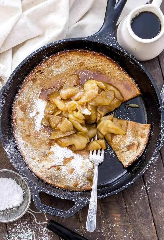 Your holiday breakfast isn't complete without this Gingerbread Dutch Baby with Cider Apples! This baked puffy pancake is perfectly spiced and tastes incredible with soft caramelized cider apples on top!