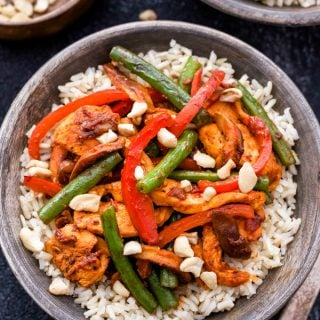 Harissa is used as both a marinade and sauce in this amazing flavored Harissa Chicken Stir Fry! An easy and healthy weeknight dinner with just enough spice to wake up your tastebuds!