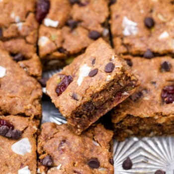 Crisp edges, a chewy center and loaded with trail mix goodies! Not only are these Oatmeal Almond Butter Trail Mix Cookie Bars a tasty treat, but they're also made with better-for-you ingredients.