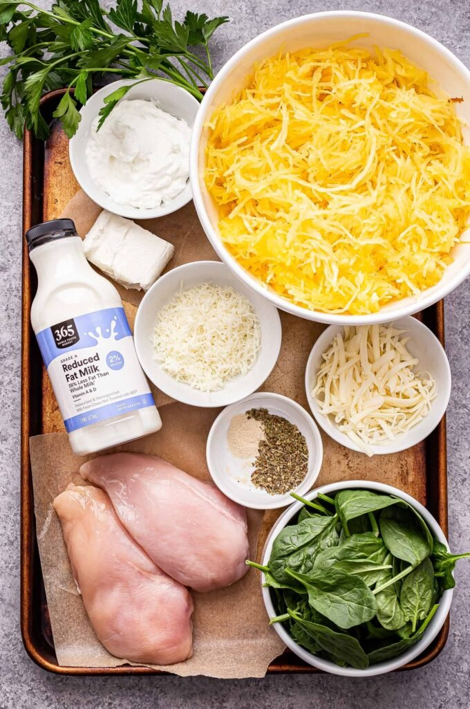 Ingredients used to make Chicken and Spinach Spaghetti Squash Alfredo on a sheet pan.