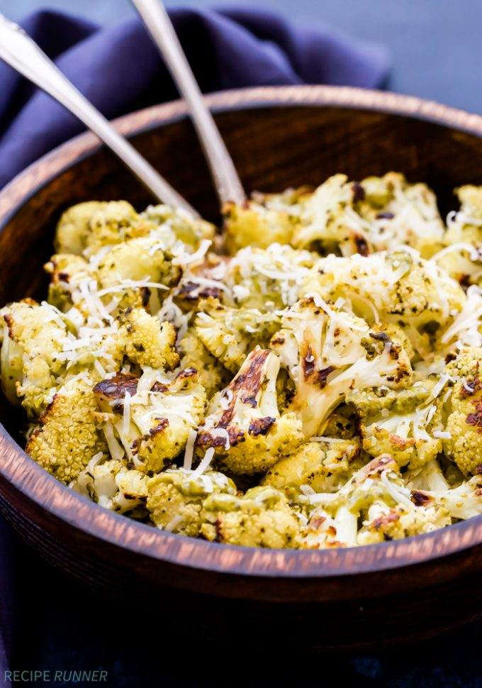 If you think cauliflower is boring and flavorless, then you need to try this Parmesan Pesto Roasted Cauliflower! Perfectly caramelized and coated in pesto giving it a nutty, savory, herbaceous flavor you won't be able to resist!