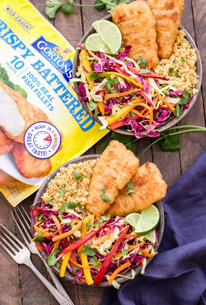 These Crispy Fish Taco Bowls with Rainbow Slaw are packed full of flavor and perfect for busy weeknights. Take your favorite whole grain and top it with crispy baked fish fillets and a crunchy cilantro honey lime flavored slaw. You'll love these hearty taco bowls!