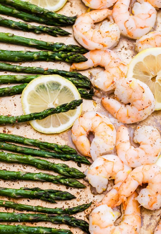 Sheet pan Lemon Roasted Shrimp and Asparagus with Herbed Couscous is one of the easiest dinners I've made and It's full of spring flavors! It can be on the table in 15 minutes or less!