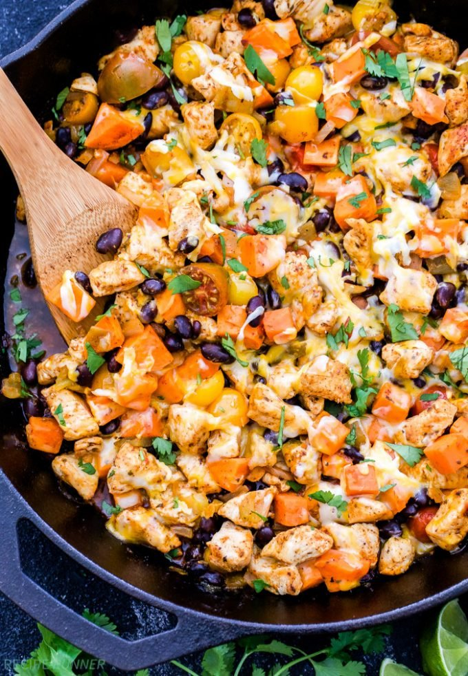 An easy dinner all made in one skillet- Mexican Chicken, Sweet Potato and Black Bean Skillet. Top this healthy dinner with shredded cheese and cilantro for a fast and delicious Mexican inspired meal!
