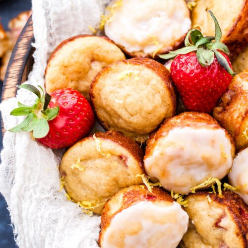 Mini Strawberry Muffins with Lemon Glaze are perfect for spring brunch! Loaded with fresh strawberries and topped with the perfect amount of sweet and tangy lemon glaze makes it hard to only eat one!