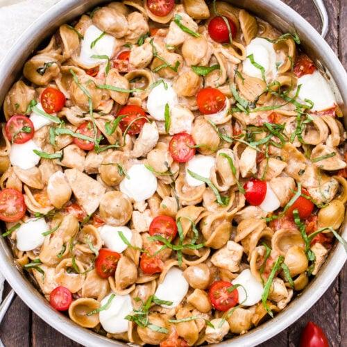 One Pot Caprese Chicken Pasta in skillet