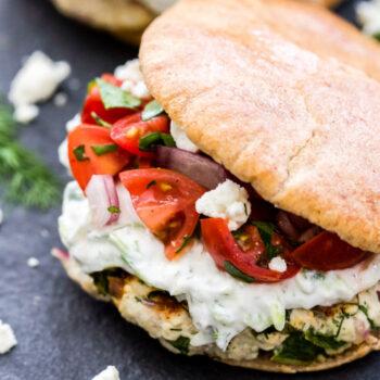 Greek Turkey Burgers with Tzatziki Sauce and Greek Tomato Salad on a pita