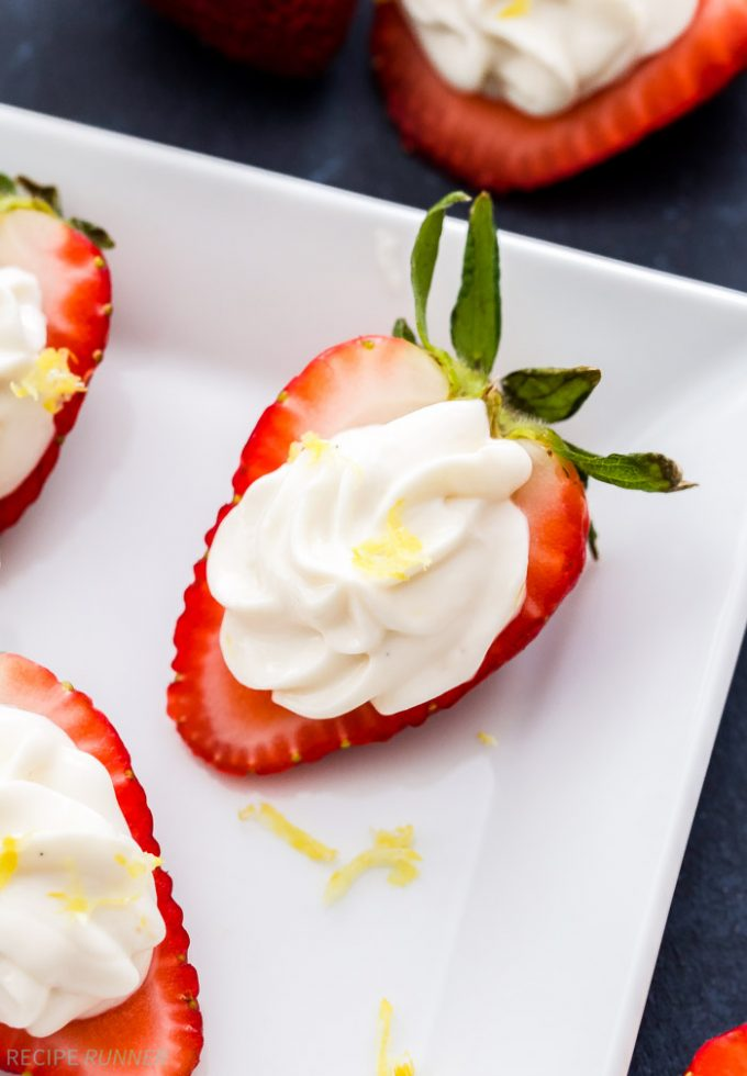 These Lemon Cheesecake Stuffed Strawberries are the perfect way to get your cheesecake fix without over doing it! They're super easy to make and great for parties too!