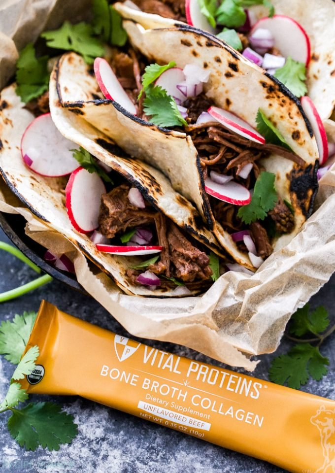 These slow cooker Sweet and Spicy Ancho Chile Short Rib Tacos are a flavorful and easy to make dinner. Tender, juicy, shredded short ribs slow cooked with a perfectly balanced sweet and spicy sauce will easily become your new favorite taco!