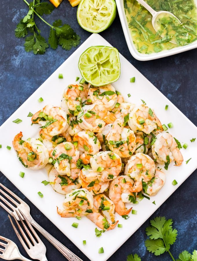 Grilled Shrimp with Citrus Marinade is a quick and easy appetizer or light dinner. Warm grilled shrimp are tossed in a fresh citrusy marinade made of fresh orange and lime juice, cilantro, fresh ginger, honey and a jalapeño for spice.