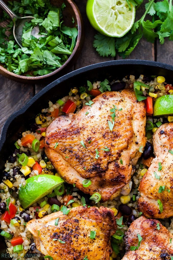 Skillet Chili Lime Chicken Thighs with Confetti Cauliflower Rice is an easy and flavorful one skillet dinner the whole family will love! Gluten-free, low in carbs and high in protein!