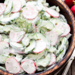 Cucumber Radish Salad with Creamy Yogurt Dill Dressing - Crisp and crunchy with a delicious creamy Greek yogurt dressing full of lemon juice and fresh dill. It's the perfect summer salad!
