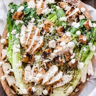 Classic Caesar salad gets a flavor facelift thanks to the grill! Romaine hearts, rosemary marinated chicken and even the bread for the croutons are all grilled to perfection in this healthy Grilled Chicken Caesar Salad!