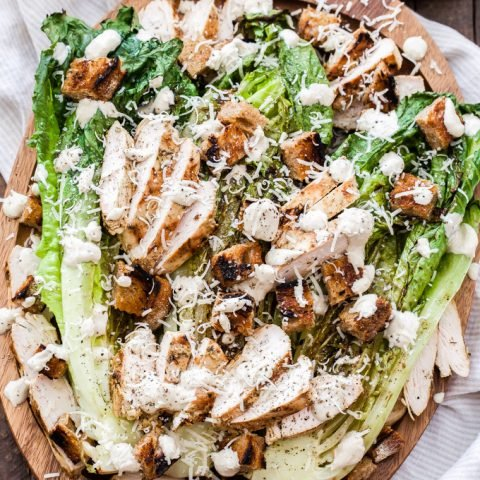 Grilled Chicken Caesar Salad on wood serving platter