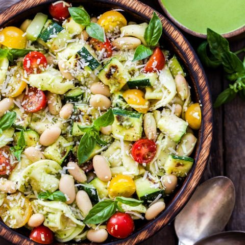 Grilled Zucchini, White Bean, Tomato and Tortellini Pasta Salad in wooden bowl