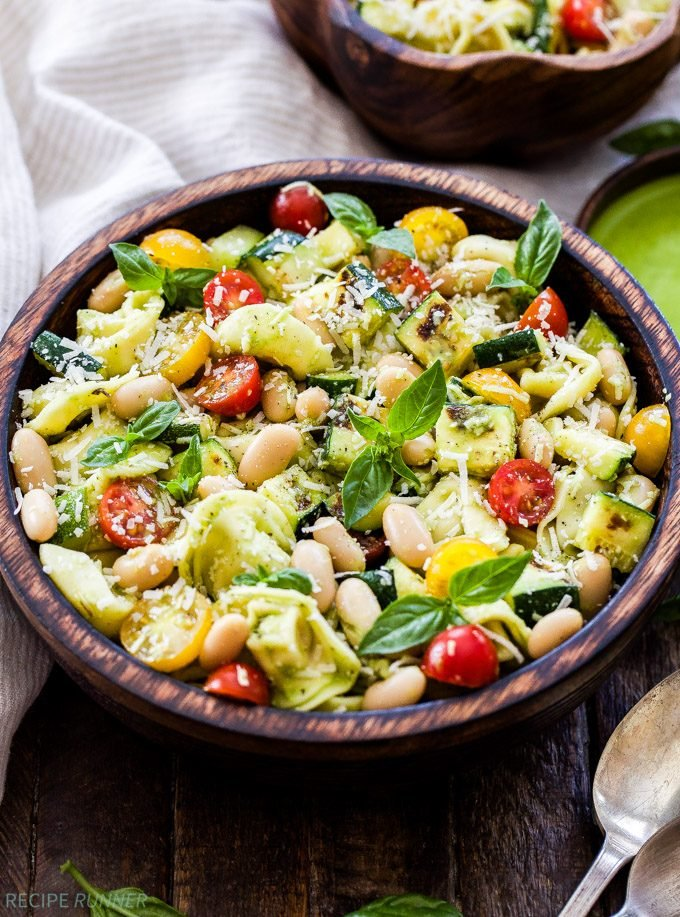 A fresh, flavorful and filling main dish pasta salad! This Grilled Zucchini, White Bean, Tomato and Tortellini Pasta Salad is easy to make and perfect for a fast and healthy weeknight dinner!