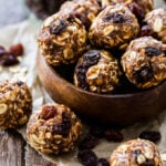 These gluten-free and vegan Oatmeal Raisin Cookie Energy Bites have all the flavor that the cookies do, but are made with wholesome ingredients. They're perfect for post workout refueling or a healthy dessert!