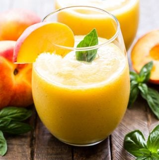 Peach Basil Frosé is the ultimate wine based summer slushie! Perfect for sipping on a hot afternoon or serve them at your next party!