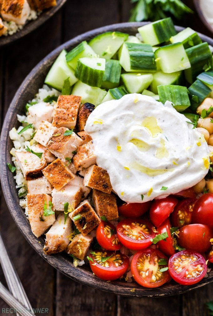 Healthy Chicken Shawarma Bowls topped with tahini yogurt sauce