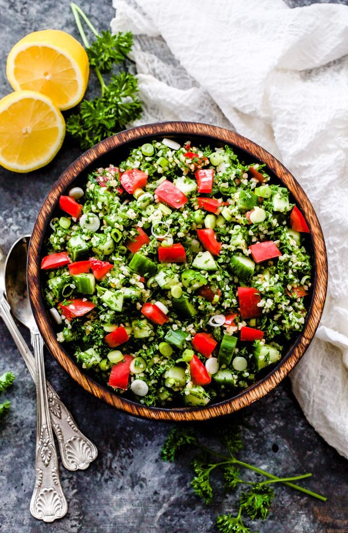 This Lebanese Tabbouleh Salad is loaded with fresh vegetables, bulgar wheat, parsley and mint. Toss everything together in fresh lemon juice and olive oil for the perfect, easy to make salad!